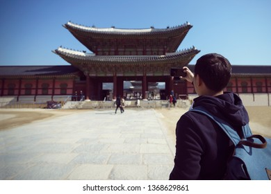 Young asian traveler with backpack traveling to Gyeongbokgung Palace, Seoul South Korea