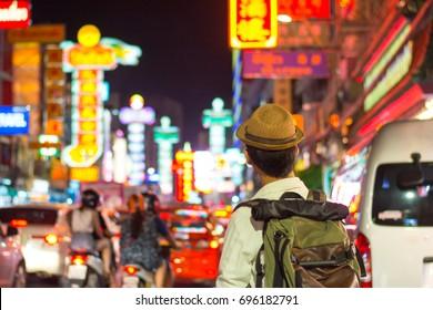 Young Asian traveler  in China town at night in Bangkok, Thailand