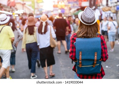 Young Asian traveling women traveling backpacker in Khaosan Road on holiday .at Bangkok Thailand, traveler and tourist concept.