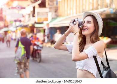 Young Asian traveling women traveling backpacker and take photo on holiday at Bangkok Thailand, traveler and tourist concept.
