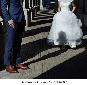 young asian wedding couple holding hands, groom and bride just happy together