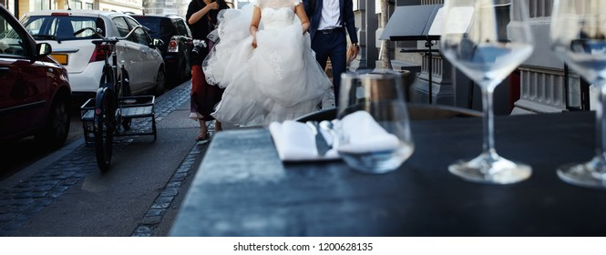 young asian wedding couple walking downtown, groom and bride just happy together