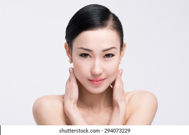 Young Asian woman with beautiful face and clear skin