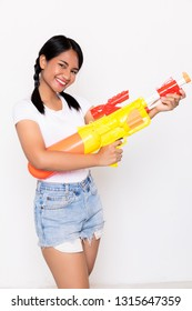 Young  Asian woman beauty holding plastic water gun with happy at Songkran festival, Thailand. on white background.