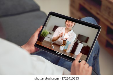 Young Asian woman beauty vlogger video online is showing make up on cosmetics products and live video on tablet. e-learning concept.