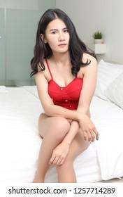 young asian woman in bikini in bed room