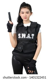 young asian woman in black clothes with bulletproof vest and holding gun