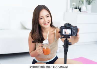 Young Asian woman blogger setting camera video with recording filming at home, review healthy woman concept.making vlog. vlog concept