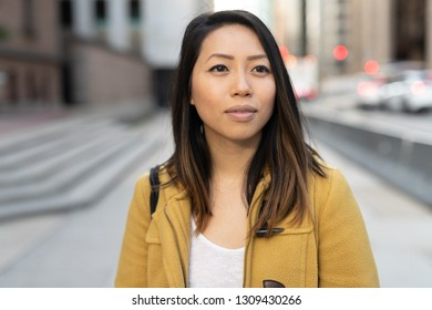Young Asian woman in city walking street