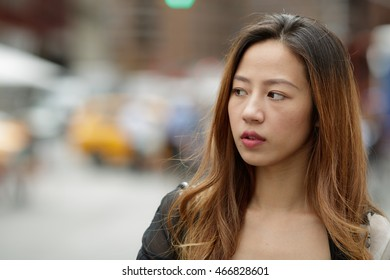 Young Asian woman in city walking smile face
