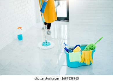 Young asian woman cleaning house Sweeping the floor with a mop House keeping concept