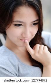 Young Asian woman close up shot.