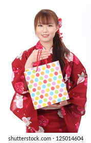 Young asian woman in clothes of kimono with shopping bag
