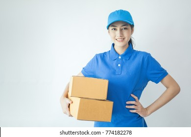 Young Asian Woman with Delivery service worker in uniform. Woman holding Box with attractive  smiling isolated on white background.