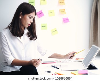 Young Asian woman designer working in her office.