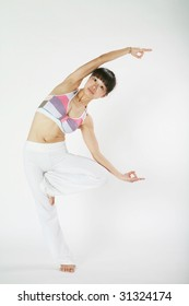 young asian woman doing YOGA in with white background