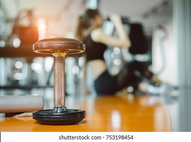 Young asian woman drinking protein shake from bottle after workout exercise for muscle at fitness gym healthy lifestyle bodybuilding sitting, Closeup dumbbell - Shutterstock ID 753198454