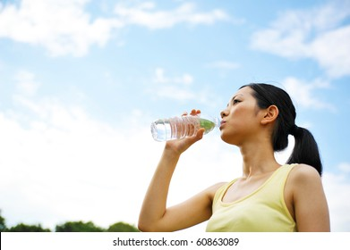 young asian woman drinking water