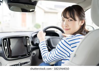 Young asian woman driving a car. - Shutterstock ID 1821964010