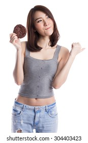 Young asian woman eating chocolate chip cookies, isolated on white background.