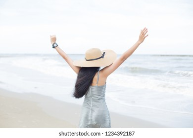 young asian woman enjoy her freedom on the tropical beach