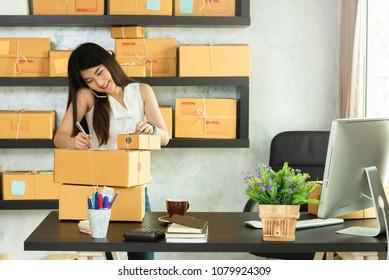 Young asian woman entrepreneur, teenager business owner work at home, alpha generation life style, online business conceptual