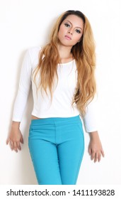 young asian woman fashion white shirt and blue pants in studio