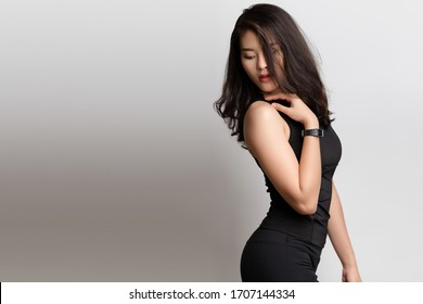 Young Asian woman with fitness clothes, healthy fit and firm body concept.