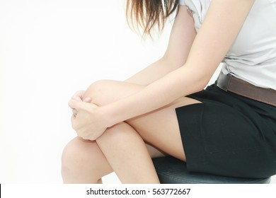 Young Asian woman get injured with knee massaging her sore knee. Joint disease treatment