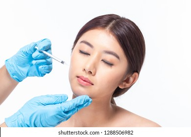 Young asian woman is getting collagen injection into her face. Beauty female face surgery close up portrait. isolated on white background.