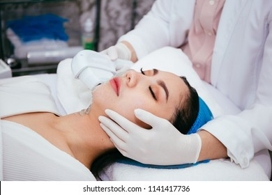 Young Asian woman getting IPL and laser treatment by beautician at beauty clinic