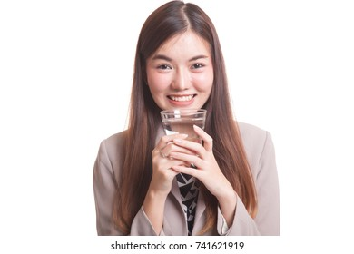 Young Asian woman with a glass of drinking water isolated on white background