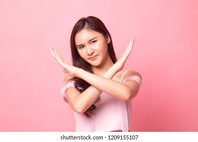 Young Asian woman got neck pain on pink background