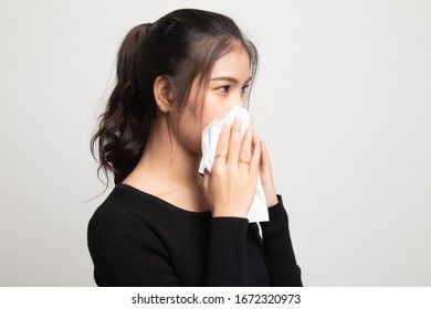 Young Asian woman got sick and flu on white background