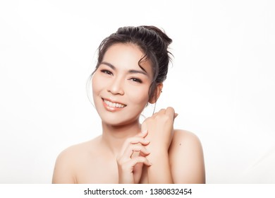 young asian woman  with happy face smiling   Studio shot isolated on white  copy space area  Closeup portrait of beautiful Asian woman,Thai girl for happiness and beauty concept