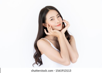 Young asian woman has smiling face and bright skin tone.Asian woman standing with isolated white background.