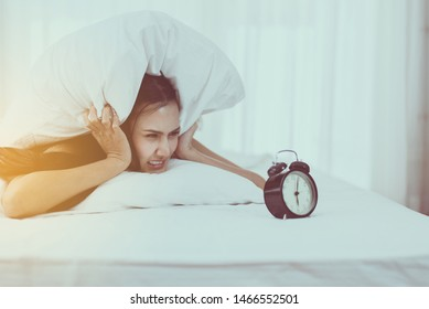Young asian woman hates getting stressed waking up early 6 o'clock,Alarm clock