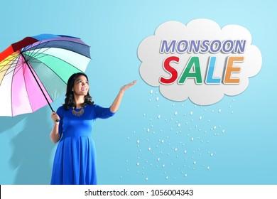 Young asian woman having fun with rain. Monsoon sale concept