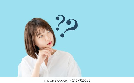 Young asian woman having questions.