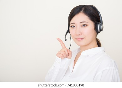 young asian woman with headset
