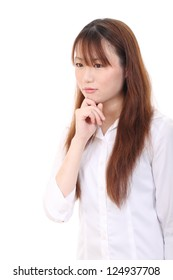 Young asian woman with her finger by her face