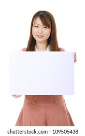 Young asian woman holding a blank white board