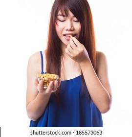 Woman Eating Peanuts Images, Stock Photos & Vectors