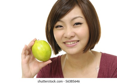 young asian woman holding green lime