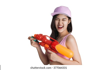 Young Asian woman holding plastic water gun at Songkran festival, Thailand.