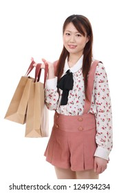 Young asian woman holding shopping bags isolated no white background
