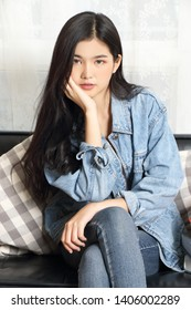 young asian woman jeans jacket in studio