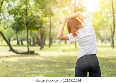 young asian woman jogging or exercise in green park .sporty woman concept.