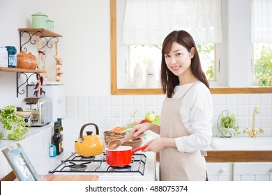 Asian lady cooking
