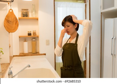 young asian woman in the kitchen